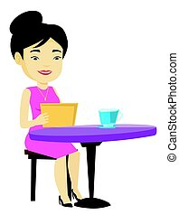 Woman surfing in the social network in cafe.