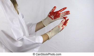 woman surgeon blood glove - Woman surgeon doctor in white...
