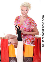 Woman surrounded by bags
