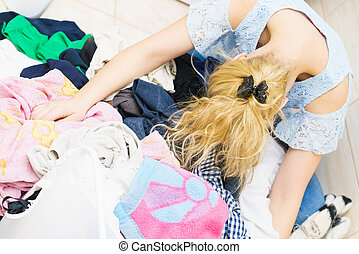 Woman surrounded by clothing