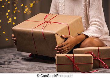 Woman surrounded by presents