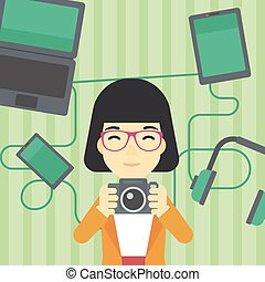 Woman surrounded with her gadgets.