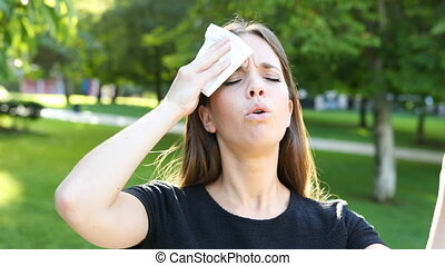 Woman sweating and suffering heat stroke - Overwhelmed woman...