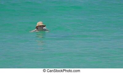 Woman swimming in the ocean