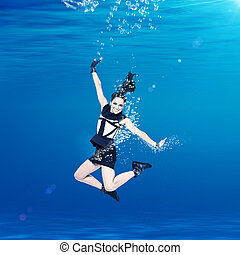 Woman swimming undewater in the sea