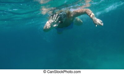 Woman Swimming with Snorkel in Red Sea