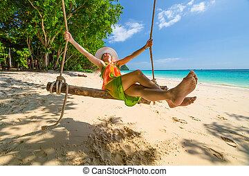 Woman swing on the beach