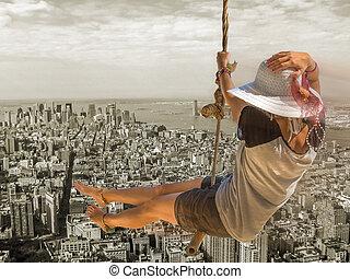 Woman swing over New York Skyline