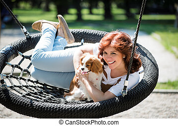 Woman swing with her dog
