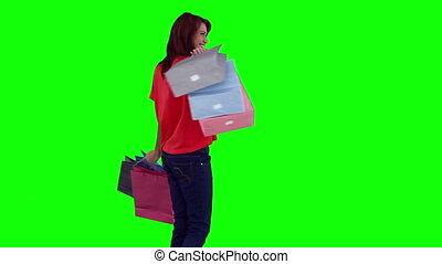 Woman swinging her shopping bags
