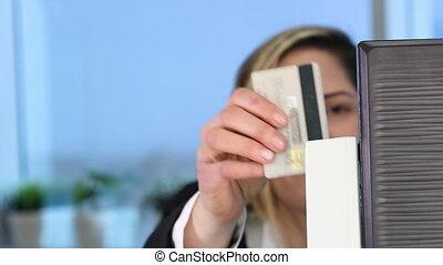 Woman swipe credit card - Woman Swiping Credit Card Through...