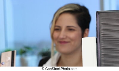 Woman swiping credit card - Woman Swiping Credit Card...