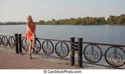 Woman take a rest on embankment