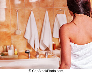 Woman take bubble bath. - Interior of bathroom with young...