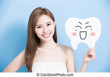 woman take cute tooth