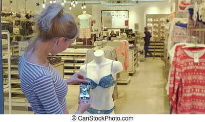 Woman takes picture of underwear on mannequin - Pretty...