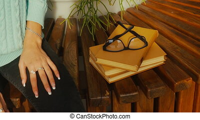 woman takes reading glasses in the street - girl takes...