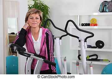 Woman taking a break at the gym