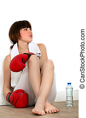 Woman taking a break during a boxing session