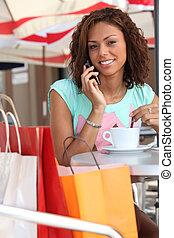 Woman taking a break from shopping