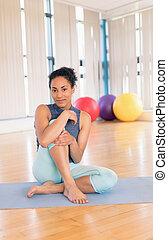 Woman taking a break in gym