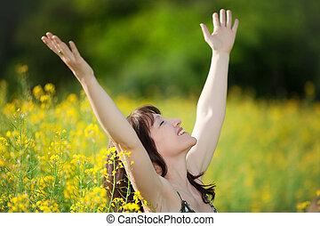 woman taking a breath - happy woman breathing in yellow...