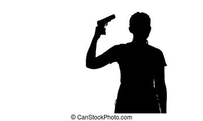 Woman taking a gun to her temple and trying to kill herself. Silhouette. White