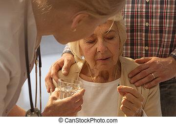 Woman taking a medicine
