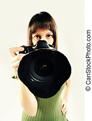 Woman taking a photo with a digital SLR camera with a digital SLR camera