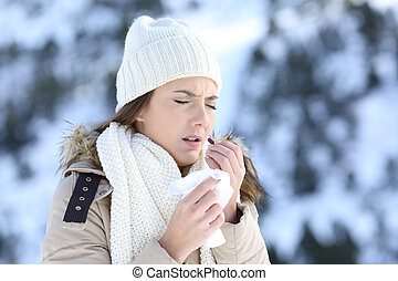Woman taking a pill in a cold snowy winter