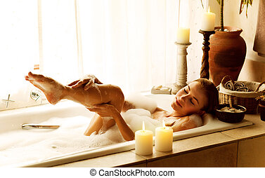 Woman taking bath - Photo of a woman relaxed at luxury spa...