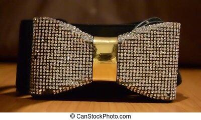 woman taking Beautiful shiny bow Waist Belt rotating shot -...