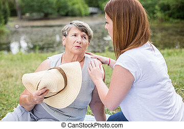 Woman taking care of grandmother