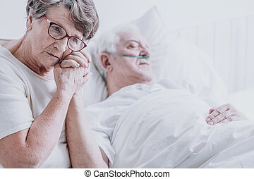 Woman taking care of husband