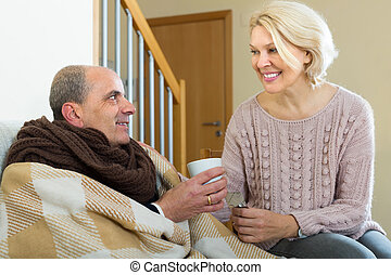 Woman taking care of senior patient