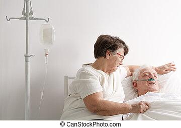 Woman taking care of sick husband