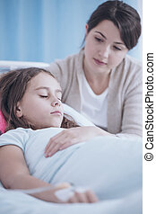 Woman taking care of sick younger sister during stay in a private clinic