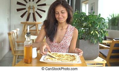 Woman taking cheese pizza cut