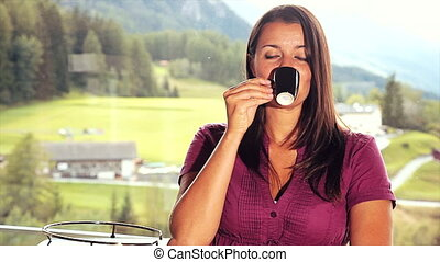 Woman taking coffee at home