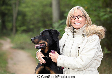 Woman taking dog for a walk