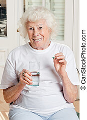 Woman Taking her Medicine