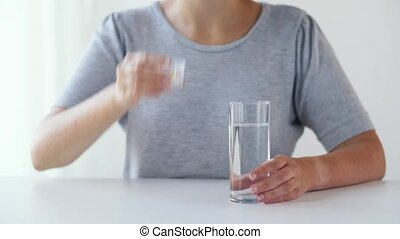 woman taking medicine and drinking water - medicine,...