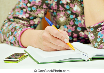 Woman taking notes in Notepad.