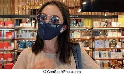 Woman taking off mask in beauty shop - Young female in ...