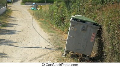 Woman Taking Out the Litter to Street Container - Young...