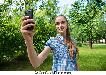 Woman taking photo on her mobile phone