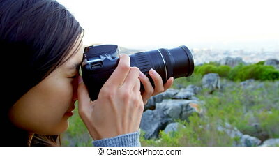 Woman taking photo with digital camera 4k - Woman taking...
