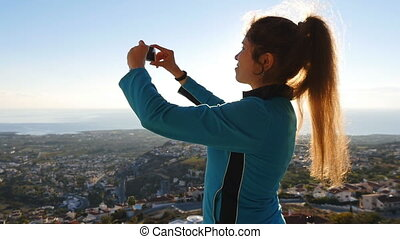 Woman taking photo with smart phone. Travel concept
