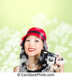 Woman taking photographs with vintage camera - Retro photo...