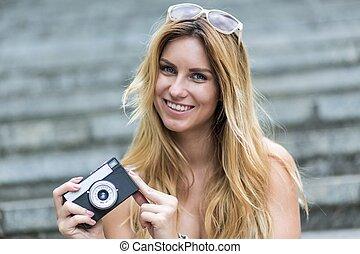 Woman taking photos during summer